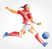 Female soccer player kicking the ball. Woman soccer player kicking the ball made of colorful brushstrokes on light background Stock Photo