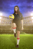 Woman soccer player on stadium Royalty Free Stock Images