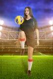 Woman soccer player on stadium Royalty Free Stock Photos