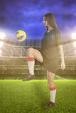 Woman soccer player on stadium Stock Images