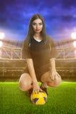 Woman soccer player on stadium Stock Image
