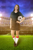 Woman soccer player on stadium Stock Photos