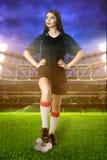 Woman soccer player on stadium Stock Photography