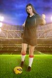 Woman soccer player on stadium Royalty Free Stock Photo