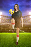 Woman soccer player on stadium Royalty Free Stock Image
