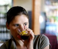 Woman with soda Stock Images