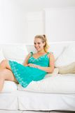 Woman on sofa Royalty Free Stock Image