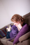 Woman on Sofa Royalty Free Stock Photos