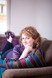 Woman on Sofa Stock Photography
