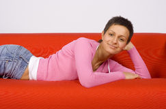 Woman on the sofa Stock Photography