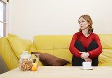 Woman on a sofa Stock Photography