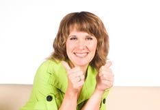 Woman at sofa Stock Images