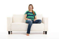 Woman at the sofa Royalty Free Stock Photography
