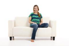 Woman at the sofa Royalty Free Stock Photography