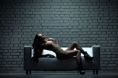 Woman on sofa Royalty Free Stock Images