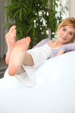 Woman on a sofa Stock Images