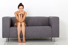 Woman on sofa Stock Photos