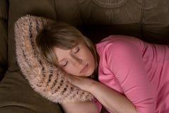 Woman at sofa Stock Photography