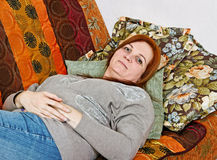 Woman on sofa. Royalty Free Stock Photo
