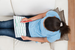 Woman On Sofa With Calendar And Pen Stock Photos