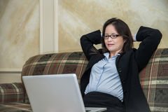 Woman on sofa on laptop Royalty Free Stock Images