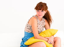 Woman on sofa laughing Stock Photos