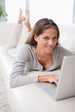 Woman on the sofa surfing the internet Stock Photo