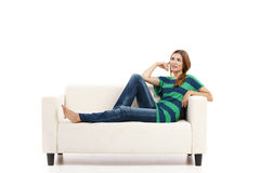 Woman at the sofa thinking Royalty Free Stock Photo