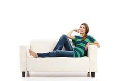 Woman at the sofa thinking Royalty Free Stock Photo