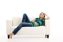 Woman at the sofa thinking Royalty Free Stock Image