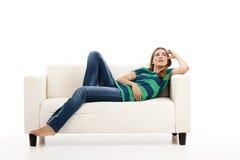 Woman at the sofa thinking Royalty Free Stock Image