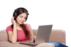Woman on sofa using laptop Stock Image