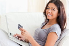 Woman on sofa woriking with notebook Stock Photo