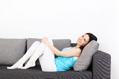 Woman on sofa Royalty Free Stock Photo