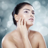 Woman with soft skin on bokeh background Stock Images