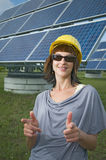 Woman and solar panels Stock Images