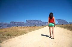 Woman and solar panels in cadiz Royalty Free Stock Images