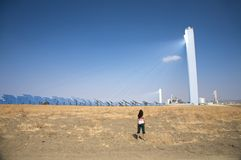 Woman at solar power station Royalty Free Stock Images