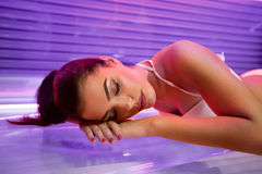 Woman in solarium Stock Photos