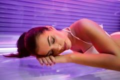 Woman in solarium. Beautiful young woman tanning in solarium Stock Photos