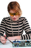 Woman soldering Stock Photography