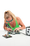 Woman soldering Stock Photo