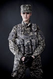 Woman Soldier. Beautiful young woman dressed in grey digital camouflage Royalty Free Stock Images