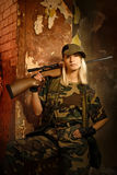 Woman soldier. Beautiful woman soldier with a sniper rifle stock photo
