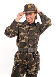 Woman soldier adjusting her hat Royalty Free Stock Photos