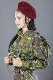 Woman soldier with backpack Royalty Free Stock Photography