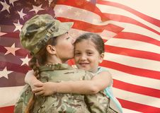 woman soldier with daughter in front of usa flag royalty free stock photos