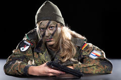 Woman soldier with gun Royalty Free Stock Photos