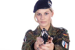 Woman soldier with gun Stock Images