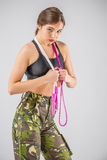 Woman soldier holding a rope elastic Royalty Free Stock Photos